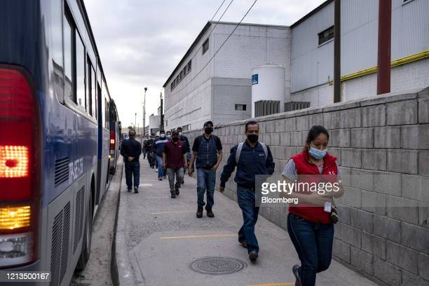 Workers wearing protective masks arrive at a Hyundai Motor Co factory in Tijuana Mexico on Monday May 18 2020 Mexican auto industry lobbies have been...