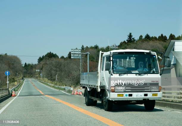 Workers wearing radiation protective gears return from the Fukushima Daiichi Nuclear Power Plant on April 15 2011 in Okuma Fukushima Japan Japanese...