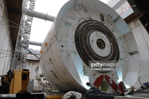 Workers weld a shield as they assemble the tunnel boring machine on the drilling site of the future Metro Line 15 South of the Grand Paris Express on...