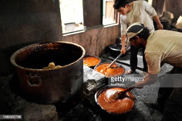 Workers whipping semi Hard molasses to molasses Chaku at Tokha Kathmandu Nepal on Thursday January 10 2019 Molasses Chaku is usually prepared and...