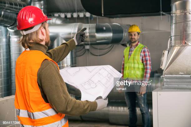 Workers with blueprint