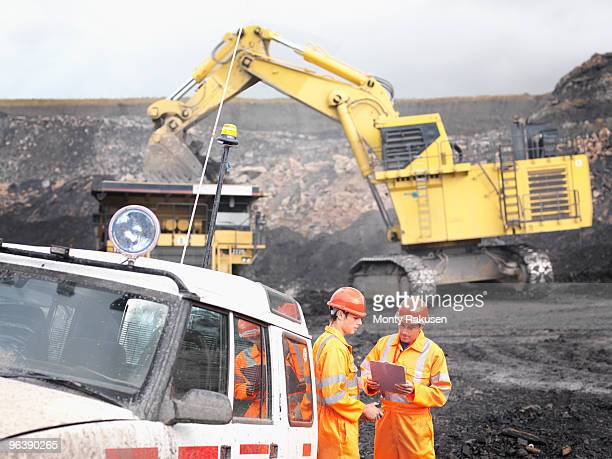 workers with clipboard in coal mine - loader reading stock pictures, royalty-free photos & images