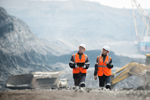 Workers with coal at open pit 587511034