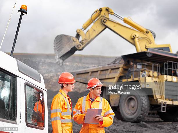 Workers With Digger In Coal Mine