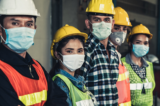 Workers with face mask protect from outbreak of Corona Virus Disease 2019. 1214440763