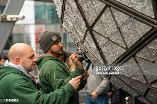 Workers with LandmarkSigns install 192 new Waterford Crystal triangles featuring this year's Gift of Goodwiil design on the Times Square Ball for New...
