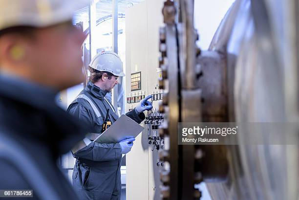 workers with machinery in hydroelectric power station - hydroelectric power station stock photos and pictures