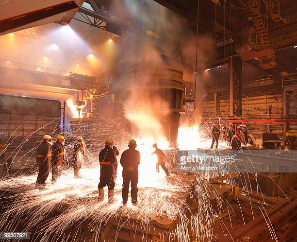 workers with molten steel in plant - sheffield stock pictures, royalty-free photos & images