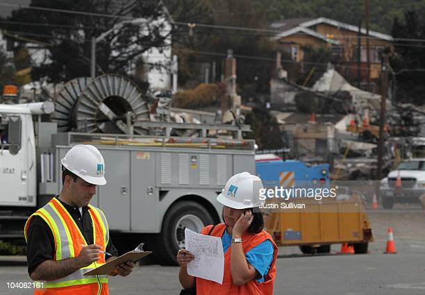 workers with Pacific Gas Electric survery the neighborhood that was rocked with a deadly gas main explosion September 13 2010 in San Bruno California...