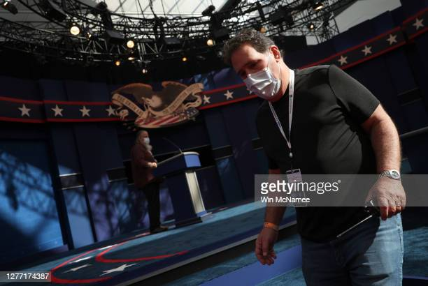 Workers with the Commission on Presidential Debates prepare the stage during a rehearsal for the first presidential debate between U.S. President...