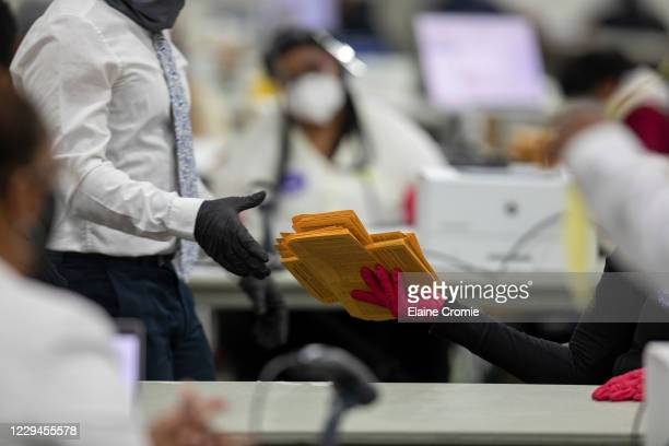 Workers with the Detroit Department of Elections help organize absentee ballots at the Central Counting Board in the TCF Center on November 4, 2020...