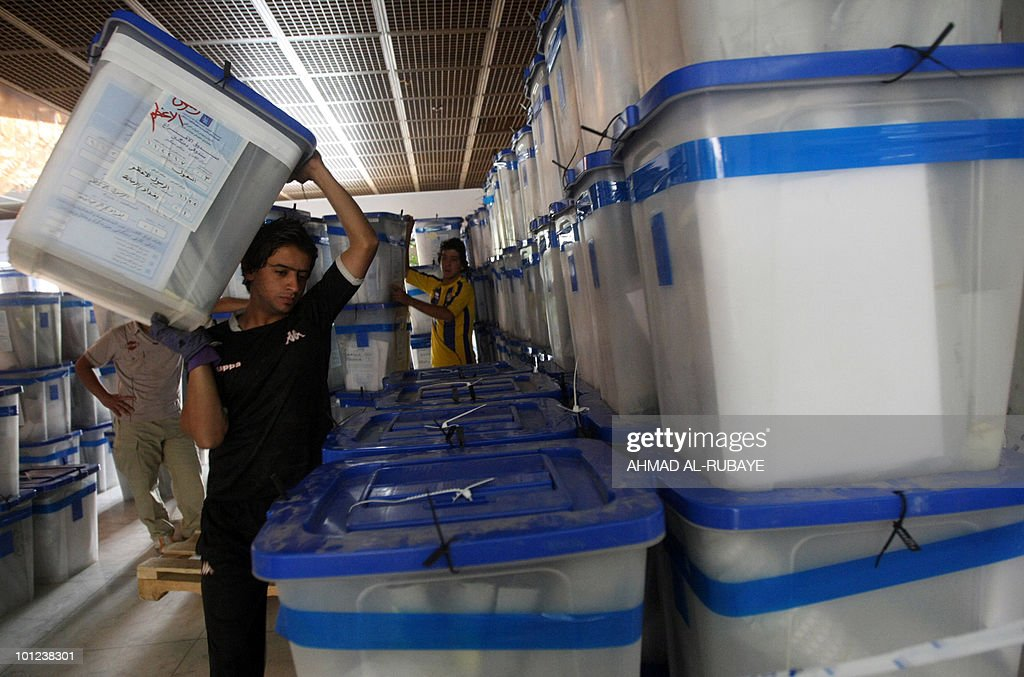 Workers with the Independent High Electoral Commission (IHEC) prepare ballot boxes to transport them for storage after finishing the recounting process in Baghdad on May 14, 2010. Electoral authorities carried out a recount in Baghdad, Iraq's biggest electoral constituency with 68 of the 325 parliamentary seats up for grabs, for 11 days.