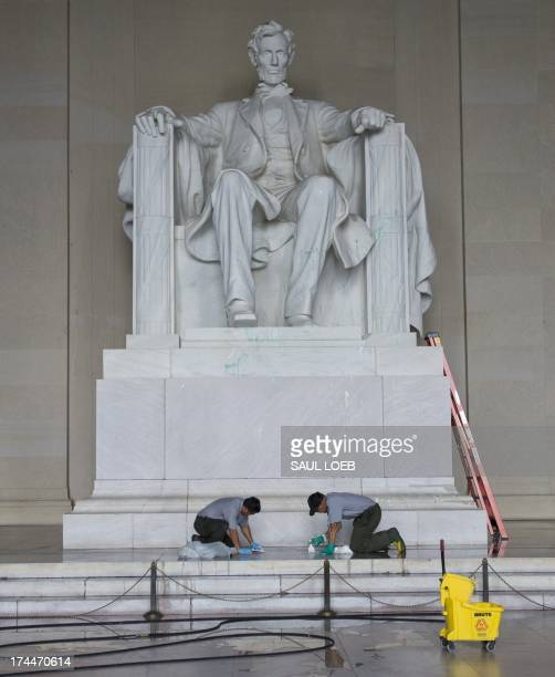 Workers with the National Park Service cleans off paint thrown on the Lincoln Memorial overnight by vandals on the National Mall in Washington DC...