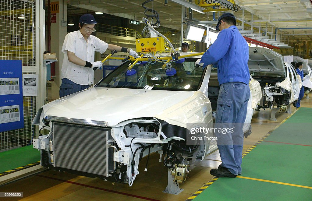 workers work at a product line of buick excelles at a new plant, the