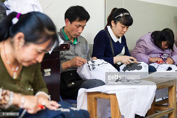 Workers work at a small fabric factory at Kanglecun one of the urban villages in Guangzhou on February 29 2016 in Guangzhou Guangdong Province China...