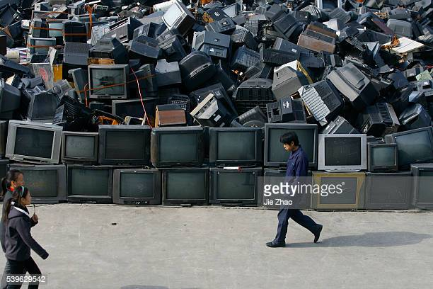 Workers work at an electronic waste recycling factory in Jingmen Hubei province December 3 2009 VCP