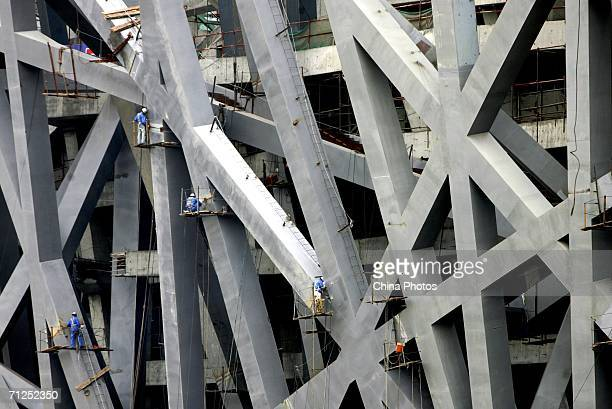 Workers work at the construction site of the National Olympic Stadium on June 20, 2006 in Beijing, China. The main body of the National Olympic...