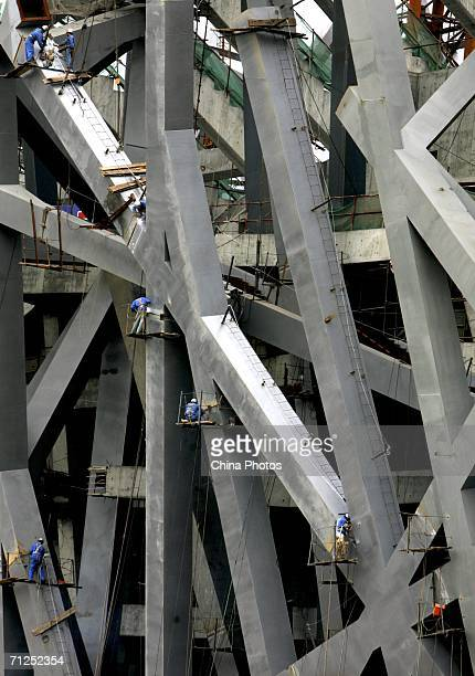 Workers work at the construction site of the National Olympic Stadium on June 20 2006 in Beijing China The main body of the National Olympic Stadium...