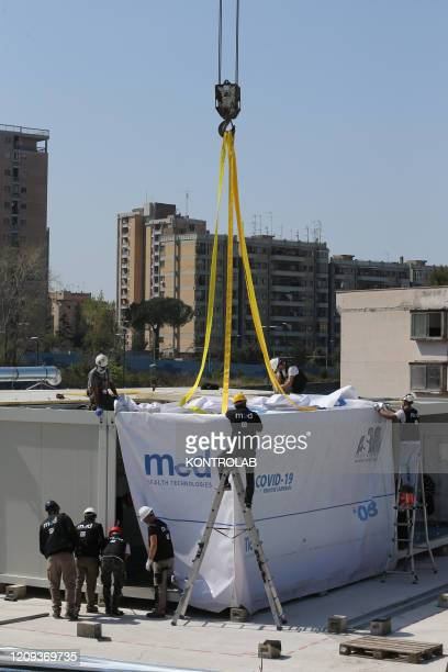 Workers work in the building site of the new Covid-19 section of the hospital Ospedale del Mare in Ponticelli distict. In Italy the lockdown still...