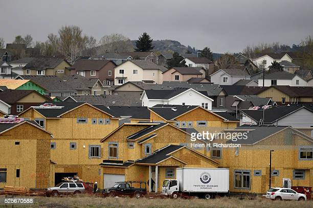 Workers work on new homes in the Meadows area on April 28 2016 in Castle Rock Colorado The town will hold a growth open house to explain the pace of...