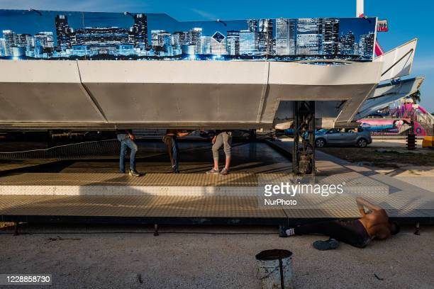 Workers work on the installation of a carousel in the Luna Park in Molfetta on October 2nd 2020 Although in this period there has been an increase in...