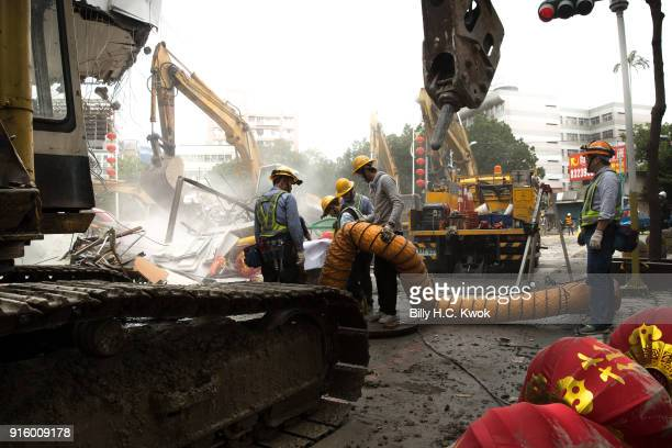 Workers work outside a collapsed hotel on February 9 2018 in Hualien Taiwan The 64 magnitude earthquake hit late Tuesday night According to reports...