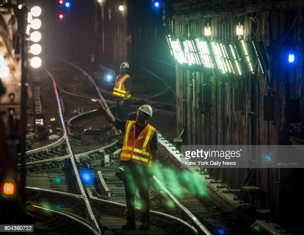 MTA workers work to repair the tracks following yesterday's train derailment at 125th Street Subway Station in Harlem on Wednesday June 28 2017