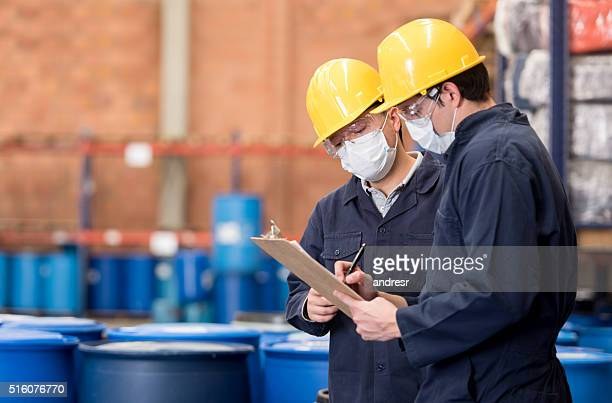 workers working at a chemical plant - chemistry stock pictures, royalty-free photos & images
