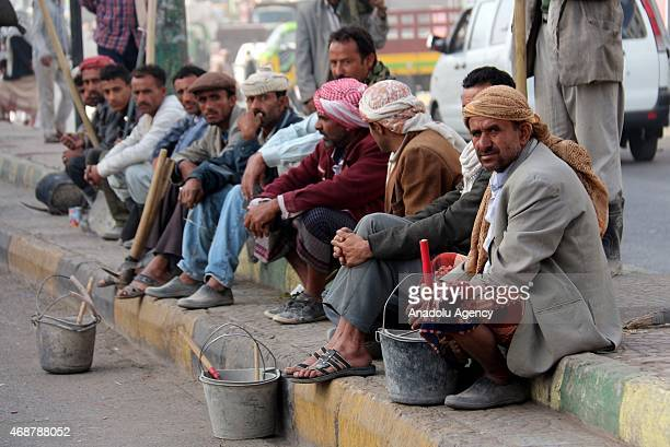 Workers working daily wait at pavement to find a job in Ibb Yemen on April 07 2015 After the Saudiled operations people having difficulties to find a...