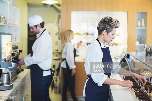 workers working in cafe - chocolate factory stock photos and pictures