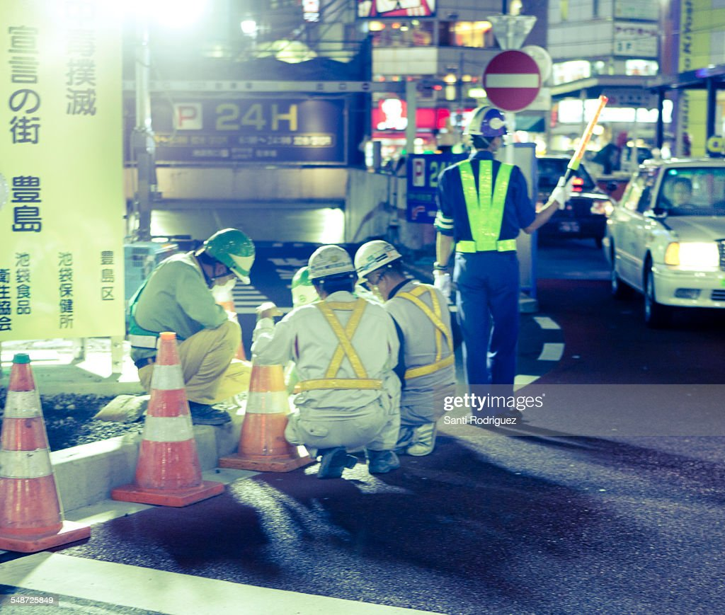 Workers working on a street : Stock Photo