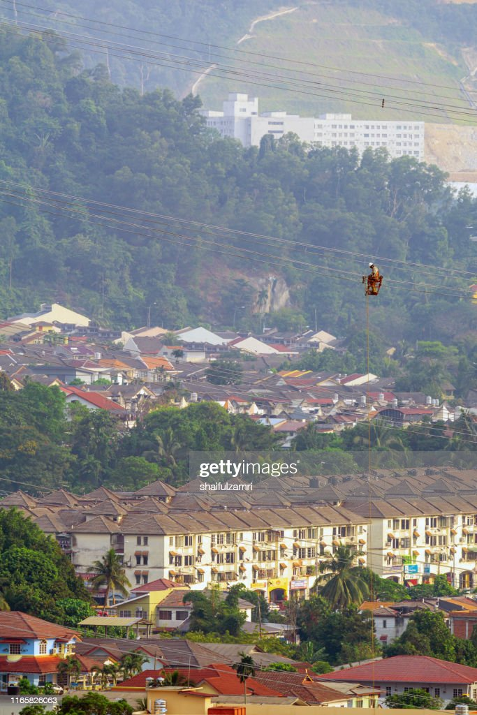 Workers working on power lines at sub urban area of Kuala Lumpur, Malaysia. : Stock Photo