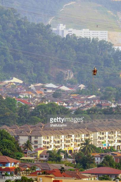 workers working on power lines at sub urban area of kuala lumpur, malaysia. - shaifulzamri fotografías e imágenes de stock