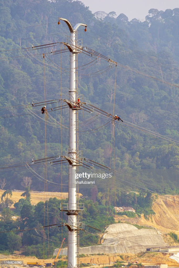 Workers working on power pole at sub urban area of Kuala Lumpur, Malaysia. : Stock Photo