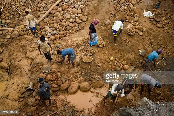 Workers working to extract stone inside a stone extraction site on April 4 2015 in Jaflong Sylhet Bangladesh Stone workers live a miserable life in...