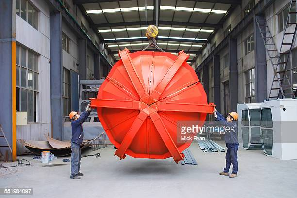 workers working together in crane manufacturing facility, china - industrial equipment stock pictures, royalty-free photos & images