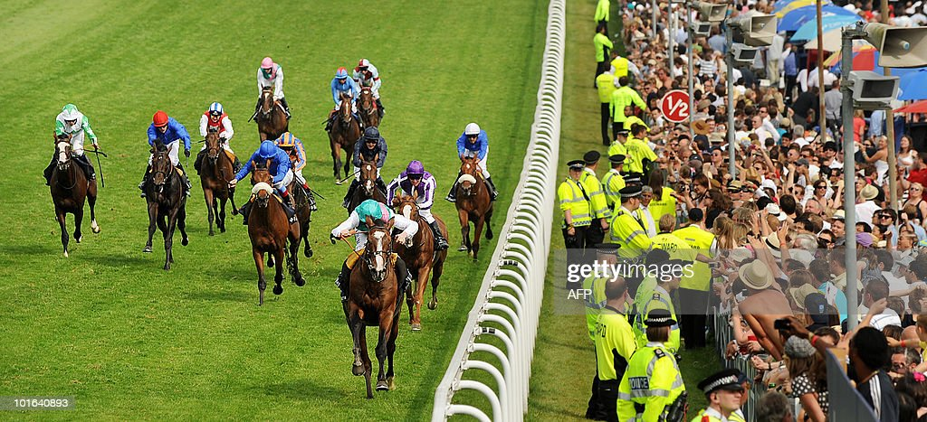 Workforce ridden by British jockey Ryan Moore (3rd R) wins the Derby on the second day of the Epsom Derby, in Surrey, southern England, on June 5, 2010.