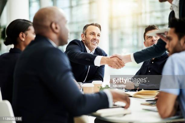 working alongside some of the best - mergers and acquisitions stock pictures, royalty-free photos & images