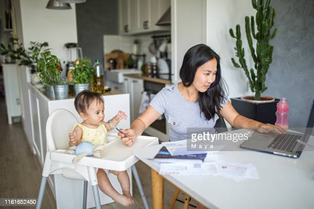 working and spending time with baby - working mother stock pictures, royalty-free photos & images