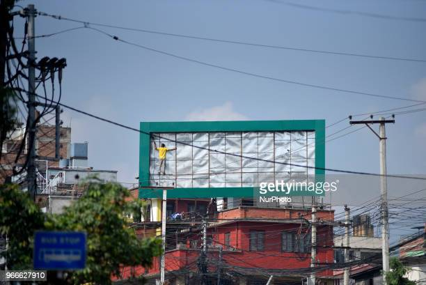 A working arranging to install Road Hoarding Board at Lalitpur Nepal on Sunday June 03 2018