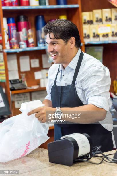 working at a convenience store - convenience store counter stock photos and pictures