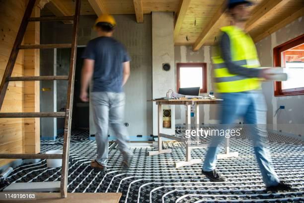 lavorare in cantiere in movimento sfocato - pavimento foto e immagini stock