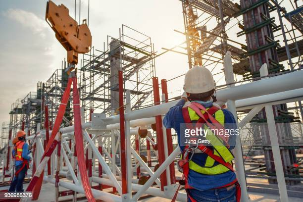 working at height equipment. fall arrestor device for worker with hooks for safety body harness on selective focus. worker as a background. - fabricage apparatuur stock pictures, royalty-free photos & images