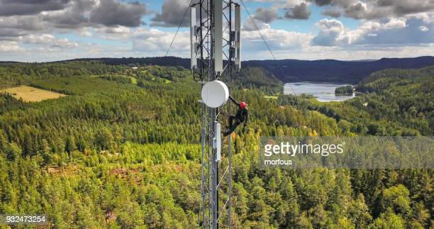 working at height - telecommunications equipment stock pictures, royalty-free photos & images