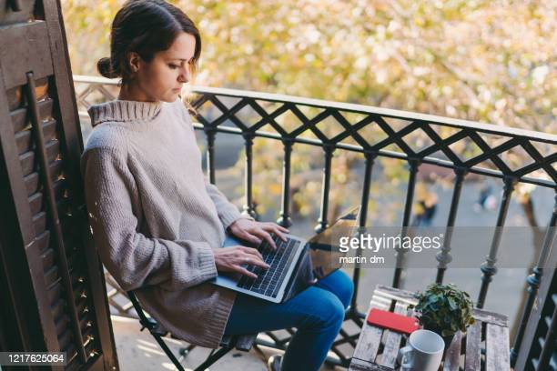 working at home during covid-19 pandemic - stay at home order stock pictures, royalty-free photos & images