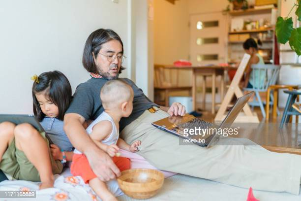 working at home father with his children - stay at home father stock pictures, royalty-free photos & images