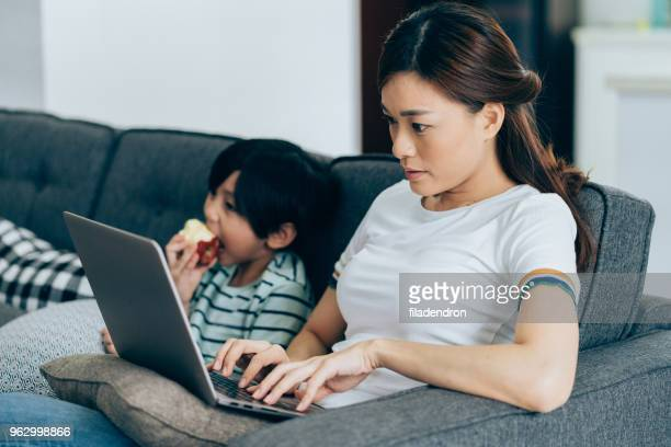 working at home mom - working mother stock pictures, royalty-free photos & images