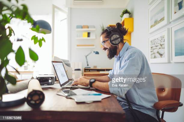 working at home - listening stock pictures, royalty-free photos & images