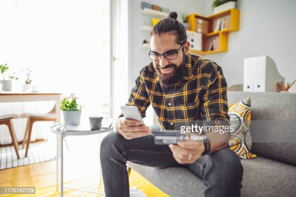 working at home - man shopping stock pictures, royalty-free photos & images