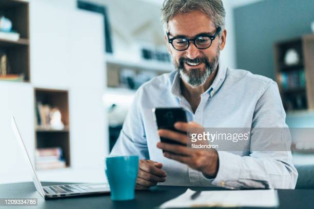 working at home - only mature men stock pictures, royalty-free photos & images